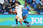 Getafe CF's Allan Nyom (r) and Sevilla FC's Sergio Reguilon during La Liga match. February 23,2020. (ALTERPHOTOS/Acero)