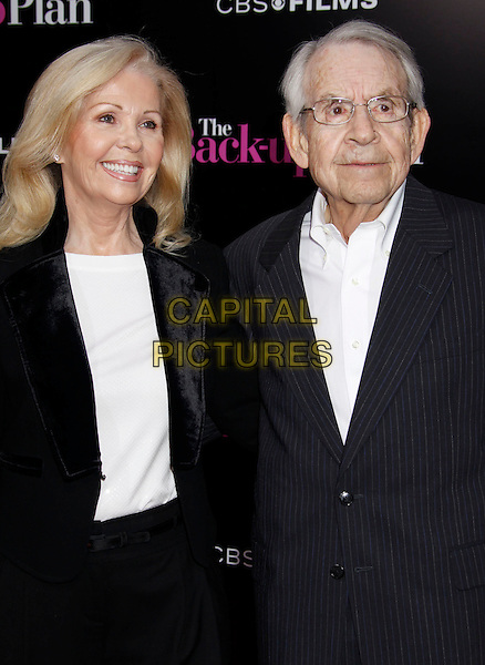 """PATRICIA CARR & TOM BOSELY .""""The Back-up Plan"""" Los Angeles Premiere held at the Regency Village Theatre, Westwood, California, USA, 21st April 2010. .arrivals half length black suit jacket white shirt married couple husband wife glasses .CAP/ADM/MJ.©Michael Jade/AdMedia/Capital Pictures."""