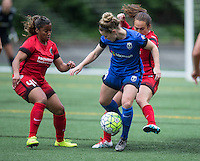 Seattle, Washington - Saturday May 14, 2016: Portland Thorns FC defender Meg Morris (44) and Portland Thorns FC midfielder Meleana Shim (6) defend Seattle Reign FC midfielder Kim Little (8) during the first half of a match at Memorial Stadium on Saturday May 14, 2016 in Seattle, Washington. The match ended in a 1-1 draw.