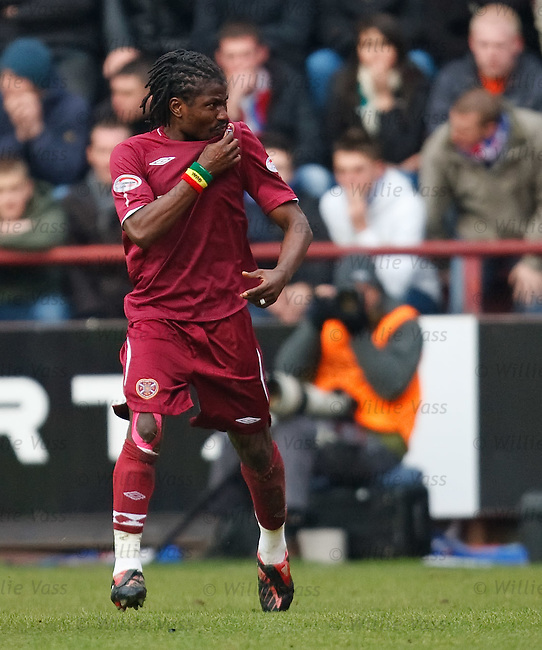 Laryea Kingston celebrates his goal for Hearts by kissing the badge.