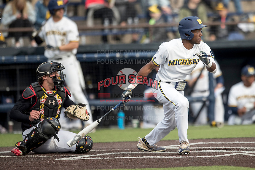 Michigan Wolverines outfielder Christian Bullock (5) follows through on his swing against the Maryland Terrapins on April 13, 2018 in a Big Ten NCAA baseball game at Ray Fisher Stadium in Ann Arbor, Michigan. Michigan defeated Maryland 10-4. (Andrew Woolley/Four Seam Images)
