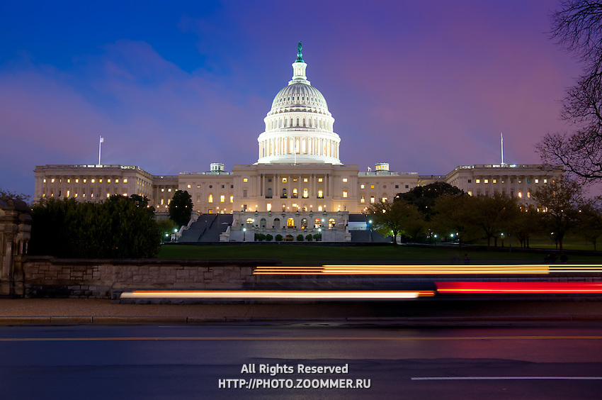 The US Congress House (Capitol) at night with light streaks from cars