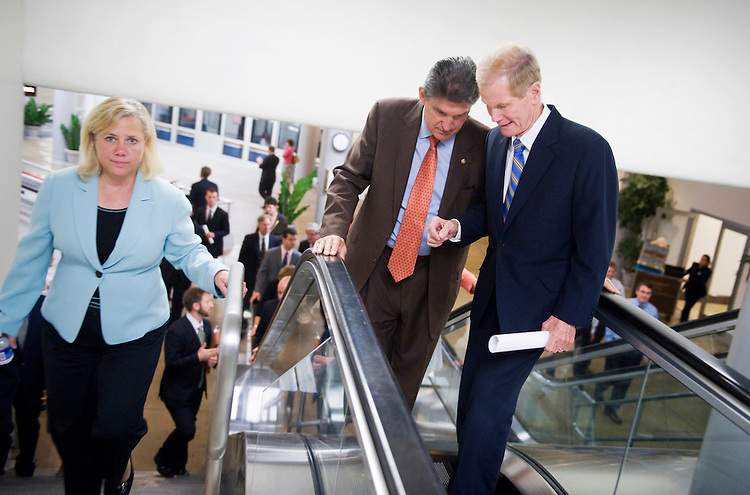 UNITED STATES - JUNE 14:  From left, Sens. Mary Landrieu, D-La., Joe Manchin, D-W.V., and Bill Nelson, D-Fla., make their way through the basement of the Capitol en route to the democratic senate policy luncheon.  (Photo By Tom Williams/Roll Call)