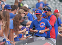 Kyuji Fujikawa (Cubs),<br /> AUGUST 7, 2014 - MLB :<br /> Kyuji Fujikawa of the Chicago Cubs signs autographs for fans during practice before the Major League Baseball game against the Colorado Rockies at Coors Field in Denver, Colorado, United States. (Photo by AFLO)