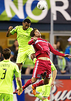Seattle Sounders FC defender James Riley, left, battles Diego Chaves of the Chicago Fire for the ball during play between the Seattle Sounders FC and the Chicago Fire in the U.S. Open Cup Final at CenturyLink Field in Seattle Tuesday October 4, 2011. Seattle won the game 2-0 to win its third U.S. Open Cup.