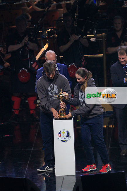 "Bradley Neil (SCO) and Kristin Gillman(USA) from the Junior Ryder Cup teams bring the ""Ryder Cup"" on stage during the Ryder Cup Gala Concert 2014 at SSE Hydro on Wednesday 24th September 2014.<br /> Picture:  Thos Caffrey / www.golffile.ie"