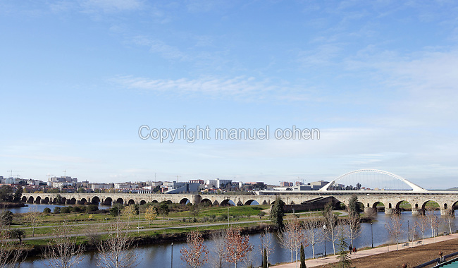 Roman bridge on the Guadiana River, built during the 1st Century BC, to establish the way out of the city through the north; length 792 meters; 60 arches; Largest ever built in the Antic Hispania; Lusitania (Hispania Ulterior) Bridge (in the distance) built by Santiago Calatrava, Merida (Augusta Emerita, Capital of Hispania Ulterior), Extremadura, Spain