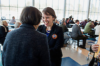 Shenna Bellows, Democratic candidate in Maine for US Senate, speaks with Mary Holt, of Chebeague Island, after Bellows spoke to the Falmouth Democratic town caucus in the Falmouth Elementary School cafeteria in Falmouth, Maine, USA, on March 3, 2014. Bellows is trying to unseat incumbent Maine Republican Senator Susan Collins in the 2014 election. The town caucus had speeches from various other local candidates and also served to choose delegates for the 2014 Maine State Democratic Caucus.