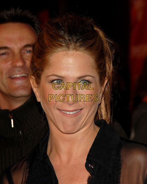 "JENNIFER ANISTON.Attends Sony Picture Classics' L.A. Premiere of ""Friends with Money"" held at The Egyptian Theatre in Hollywood, California, USA, March 27th 2006..portrait headshot ponytail smiling.Ref:DVS.www.capitalpictures.com.sales@capitalpictures.com.©Debbie Van Story/Capital Pictures"