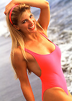 Smiling young woman in pink swimsuit