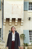 Anne collard in front of the sun dial with inscription Sine Sole Nihil.  Chateau Mourgues du Gres Grès, Costieres de Nimes, Bouches du Rhone, Provence, France, Europe