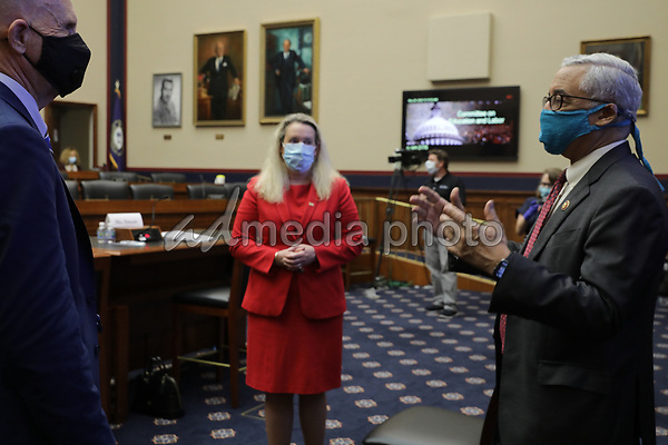 Occupational Safety and Health Administration Principal Deputy Assistant Secretary Loren Sweatt (C) and National Institute for Occupational Safety and Health Director John Howard (L) talk with United States House Education and Labor Committee Chairman US Representative Bobby Scott (Democrat of Virginia) before a hearing about the federal government's role in protecting workers during the novel coronavirus pandemic on Capitol Hill May 28, 2020 in Washington, DC. More than 62,000 health care workers have been infected with COVID-19 and close to 300 have died according to the U.S. Centers for Disease Control. <br /> Credit: Chip Somodevilla / Pool via CNP/AdMedia
