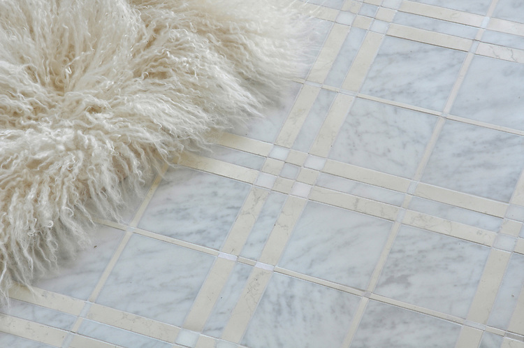 McIntyre™, a stone mosaic shown in Carrara, Bianco Antico, and Heavenly Cream honed.
