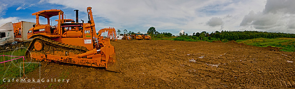 Construction vehicle - diiger working on the land