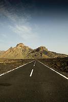 Empty road In Las Cañadas national park. Lava fields both  sides. Tenerife, Canary Islands, Spain.