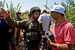 An Israeli soldier tries to prevent a press photographer from documenting events during a non-violent demonstration in the West Bank village of Beit Ummar near Hebron on 10/07/2010. The soldier had already threatened to break the camera of another photographer.