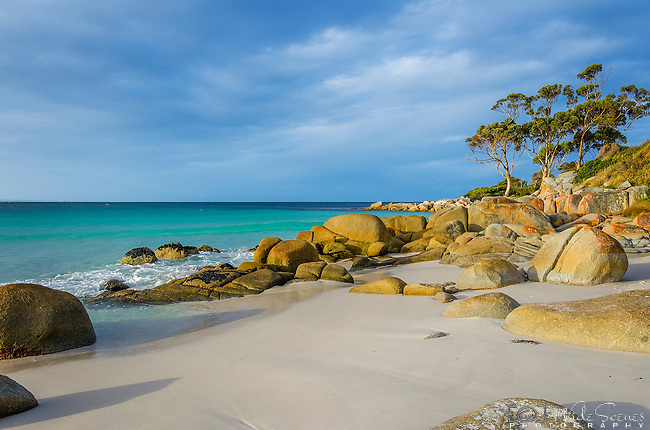 "This was taken during ""golden hour"" in the ""Bay of Fires"" on the East Coast in the small town of Binalong Bay. The whole area is quite well known for  its beautiful coastal scenes and discoloured reddish/orange boulders. The area however got its name from Captain Tobias Furneaux in 1773 when he saw the campfires of the aboriginal people along the coast."