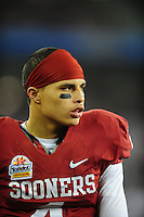 Jan. 1, 2011; Glendale, AZ, USA; Oklahoma Sooners wide receiver (4) Kenny Stills against the Connecticut Huskies in the 2011 Fiesta Bowl at University of Phoenix Stadium. The Sooners defeated the Huskies 48-20. Mandatory Credit: Mark J. Rebilas-.