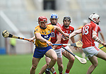 John Conlon of Clare in action against Sean O Donoghue, Christopher Joyce and Tim O Mahony of Cork during their Munster Senior game at Pairc Ui Chaoimh. Photograph by John Kelly.