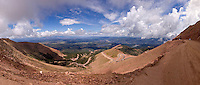 More than halfway up Pike's Peak, at about 12000 feet altitude, you are well above the timberline. From here, you can see the last of the aspens and conifers almost half a mile below,  and the Colorado plateau a mile farther down. The clouds gathering for a summer storm are at your level. Near Colorado Springs, Colorado, August 2006. clouds, cumulus, cumulonimbus, cloudbank, Colorado, mountains, sky, landscape, scenery, vacation, travel