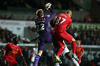 Pictured: (L-R) Simon Mignolet, Wilfried Bony, Martin Skrtel.<br /> Monday 16 September 2013<br /> Re: Barclay's Premier League, Swansea City FC v Liverpool at the Liberty Stadium, south Wales.