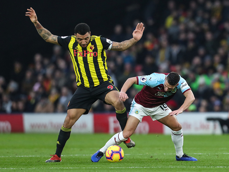 Burnley's Ashley Westwood competing with Watford's Troy Deeney<br /> <br /> Photographer Andrew Kearns/CameraSport<br /> <br /> The Premier League - Watford v Burnley - Saturday 19 January 2019 - Vicarage Road - Watford<br /> <br /> World Copyright &copy; 2019 CameraSport. All rights reserved. 43 Linden Ave. Countesthorpe. Leicester. England. LE8 5PG - Tel: +44 (0) 116 277 4147 - admin@camerasport.com - www.camerasport.com