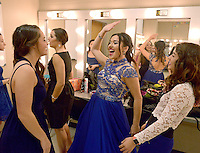NWA Democrat-Gazette/BEN GOFF @NWABENGOFF<br /> Maddie Epley (from left), and fellow contestant Kassandra Gutierrez high-five in the dressing room on Thursday Sept. 24, 2015 before Talent Night of the Miss Bentonville High School Scholarship Pageant in the school's Arend Arts Center. Evening gown, finals and awards for the pageant will be held at the school on Saturday at 7:00p.m.