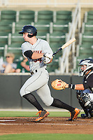 Conor Bierfeldt (34) of the Delmarva Shorebirds follows through on his swing against the Kannapolis Intimidators at CMC-NorthEast Stadium on July 2, 2014 in Kannapolis, North Carolina.  The Intimidators defeated the Shorebirds 6-4. (Brian Westerholt/Four Seam Images)