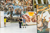 "Near life-size reproductions of Michelangelo's Sistine Chapel frescoes are seen on display in the Oculus in the World Trade Center Transportation Hub in New York on Thursday, June 22, 2017.  Entitled ""Up Close: Michelangelo's Sistine Chapel"" the 34 copies allow visitors to get up close and personal with the Florentine artist's masterpieces with the centerpiece being ""The Last Judgement"" which in Vatican City takes over the altar wall of the Sistine Chapel. The display will be on view until July 23 when it is packed up and travels to other malls. (© Richard B. Levine)"