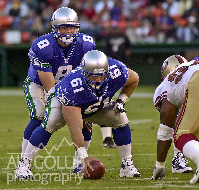 Seattle Seahawks quarterback Matt Hasselbeck (8) and center Robbie Tobeck (61) on Saturday, August 25, 2001, in San Francisco, California. The Seahawks defeated the 49ers 28-18 in a preseason game.
