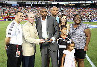 Eddie Pope and family with Kevin Payne of D.C. United during an MLS match against the Los Angeles Galaxy at RFK Stadium on July 18 2010, in Washington D.C. Galaxy won 2-1.