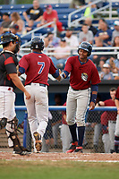 Mahoning Valley Scrappers left fielder Oscar Gonzalez (39) congratulates Will Benson (7) as he crosses home plate after hitting a home run in the top of the third inning during a game against the Batavia Muckdogs on August 18, 2017 at Dwyer Stadium in Batavia, New York.  Mahoning Valley defeated Batavia 8-2.  (Mike Janes/Four Seam Images)