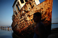 A man is seen in front of a shipwreck in Cienfuegos, Cuba on 16 March 2009.