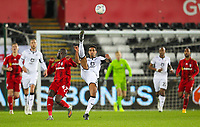 29th November 2019; Liberty Stadium, Swansea, Glamorgan, Wales; English Football League Championship, Swansea City versus Fulham; Kyle Naughton of Swansea City clears the ball under pressure from Aboubakar Kamara of Fulham - Strictly Editorial Use Only. No use with unauthorized audio, video, data, fixture lists, club/league logos or 'live' services. Online in-match use limited to 120 images, no video emulation. No use in betting, games or single club/league/player publications