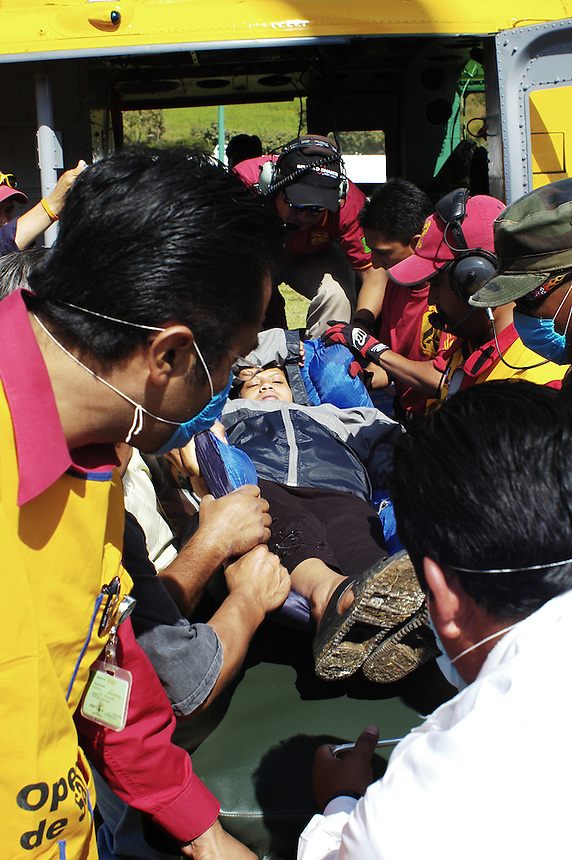 Yesenia Ortiz Perez, in labor,  had to be taken from her town Belisario Dominguez to Motozintla by helicopter.  Belisario Dominguez is cut-off from groud transportation due to the effects of huricane Stan.  Motozintla, Chiapas.