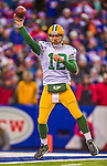14 December 2014: Green Bay Packers quarterback Aaron Rodgers makes a forward pass in the third quarter against the Buffalo Bills at Ralph Wilson Stadium in Orchard Park, NY. The Bills defeated the Packers 21-13, snapping the Packers' 5-game winning streak and keeping the Bills' 2014 playoff hopes alive. Mandatory Credit: Ed Wolfstein Photo *** RAW (NEF) Image File Available ***
