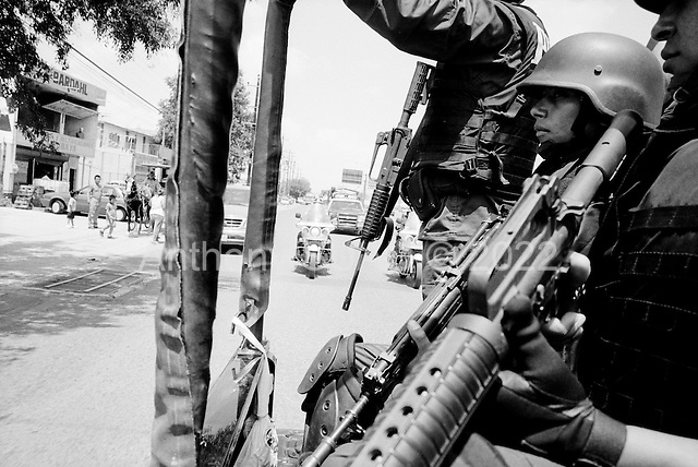 Monterrey, Mexico<br /> June 9, 2007<br /> <br /> A unit of Policia Federal Preventiva (PFP) patrols the streets of Monterrey sometimes stopping cars to search for illegal drugs. They work together on many anti-drug operations with the military.