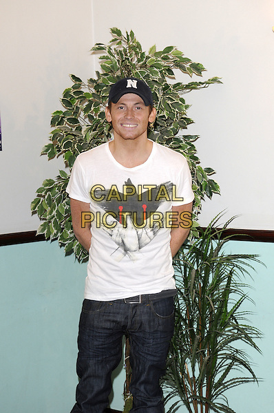 "JOE SWASH.At a press conference for the pantomime ""Cinderella"" at Central Theatre, Chatham, Kent..December 10th, 2008.panto length half 3/4 length jeans denim   white t-shirt baseball cap hat black  .CAP/FIN.©Steve Finn/Capital Pictures."