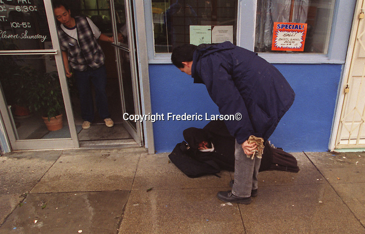 Forced from Golden Gate Park because of construction, homeless kids find shelter in store fronts must to the displeasure of shop keepers on Haight Street in San Francisco, California.