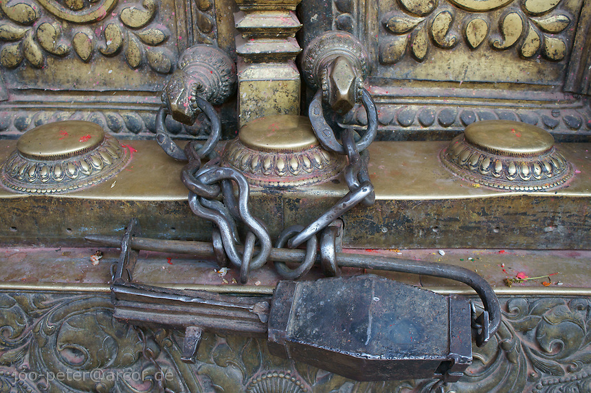 chains and lock at metal door in Bhaktapur, Nepal, October 2011