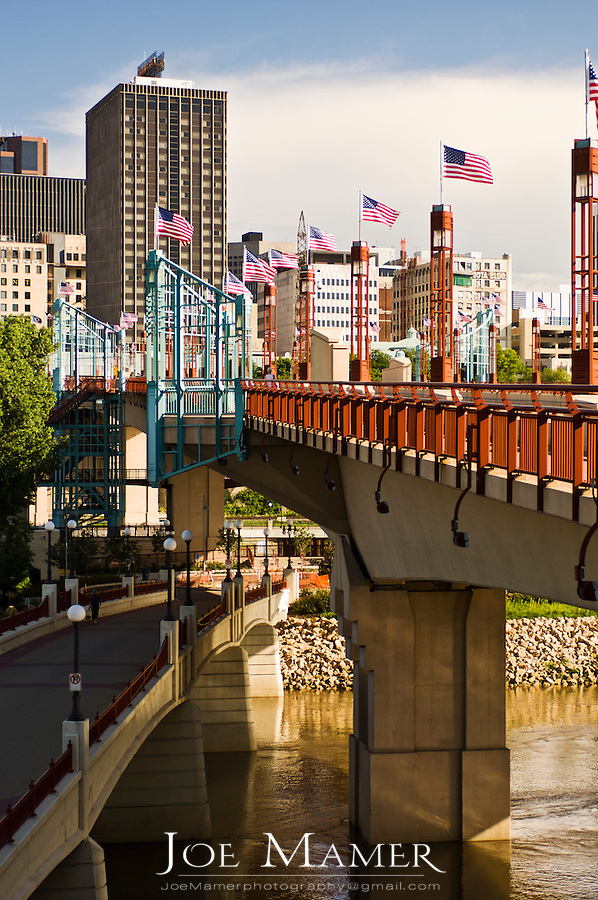 US flags line the Wabasha street bridge on a summer morning in downtown Saint Paul, Minnesota.