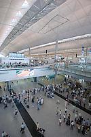 Chek Lap Kok Airport, Hong Kong .Passengers gather under a model of an historic biplane in the passenger terminal of Hong Kong's Chek Lap Kok airport..16-JUL-04