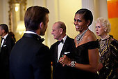 First Lady Michelle Obama greets soccer star David Beckham at a dinner in honor of Queen Elizabeth II at Winfield House in London, England, May 25, 2011. .Mandatory Credit: Pete Souza - White House via CNP