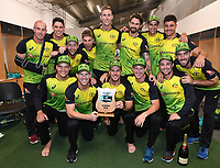 Winning captain David Warner and team mates pose for a team photo in the dressing room.<br /> New Zealand Black Caps v Australia.Tri-Series International Twenty20 cricket final. Eden Park, Auckland, New Zealand. Wednesday 21 February 2018. &copy; Copyright Photo: Andrew Cornaga / www.Photosport.nz