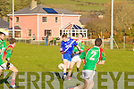 Michael O'Sullivan St Marys/Renard is disposessed by St Michaels/Foilmore's Kevin Griffin.