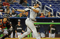 7 March 2012:  FIU utility player Oscar Aguirre (8) bats late in the game as the Miami Marlins defeated the FIU Golden Panthers, 5-1, at Marlins Park in Miami, Florida.