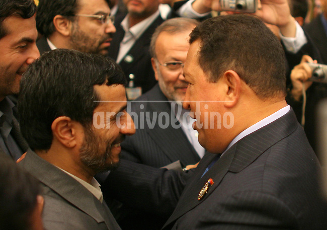 President of Iran, Mahmoud Ahmadinejad, and President of Venezuela, Hugo Chavez, speak during  the  Organization of Petroleum Exporting Countries (Opec) summit in Ryadh.