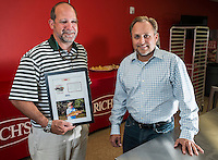 NWA Democrat-Gazette/ANTHONY REYES &bull; @NWATONYR<br /> Brent LaRoche, left, and Link Robinson, event chairmen of the Redbone at Large Fly Fishing Invitational, Tuesday, Sept. 22, 2015 at LaRoche's office in Bentonville. The event benefits the Cystic Fibrosis Foundation, Arkansas Chapter.
