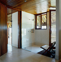 The guest bathroom has a large open shower and a door that leads directly to the terrace