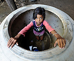 Phat Reena, 9, looks out from a large water jar in her village of Thmar Dat in northern Cambodia. Following devastating 2011 floods, Church World Service and Dan Church Aid, both members of the ACT Alliance, helped villagers to recover their homes and livelihoods.